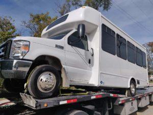 White van on open trailer transported on better dates