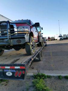 towing truck on autotransport.com's trailer for transport