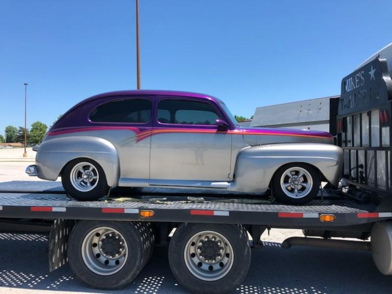 two tone classic car on trailer for auto transport