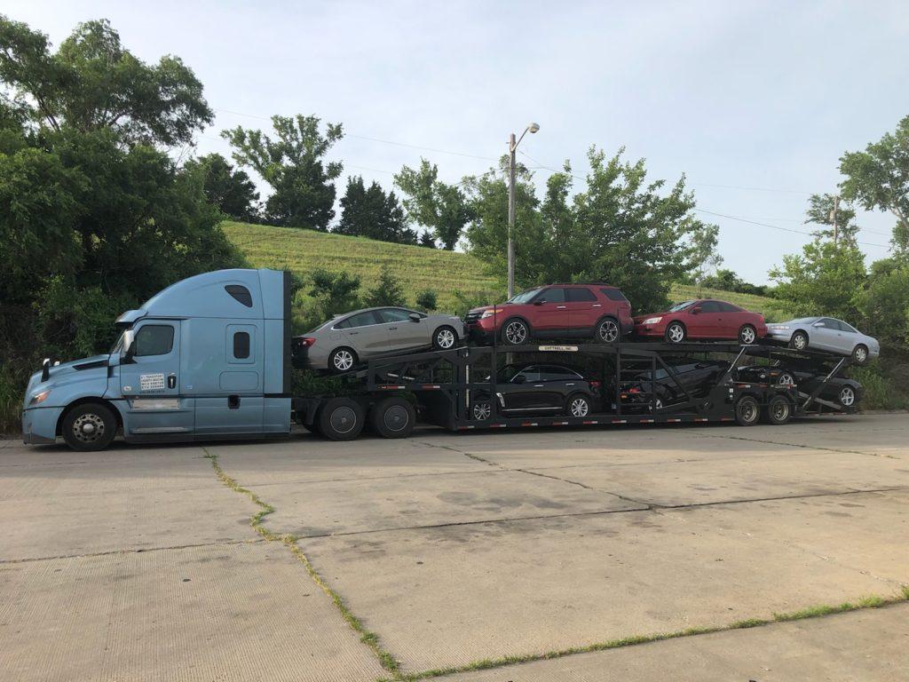 multiple vehicles on bulk auto trailer for auto transport