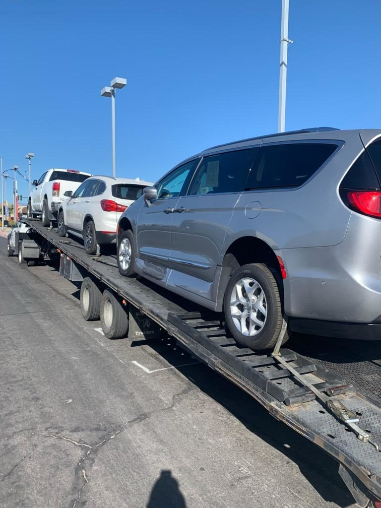 multiple cars on trailer for winter auto transport