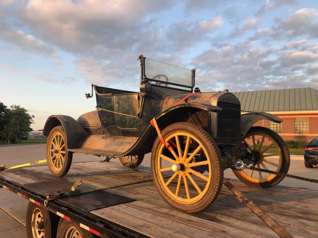 vintage vehicle used in movie set for auto transport