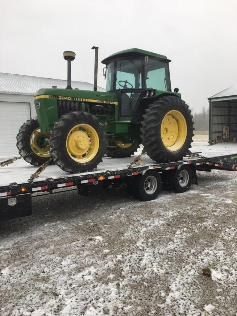 tractor being transported during the better season for transport