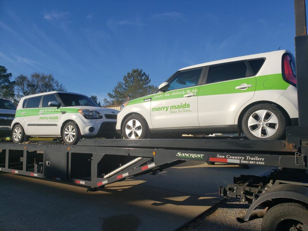 double commercial autos on trailer for auto transport