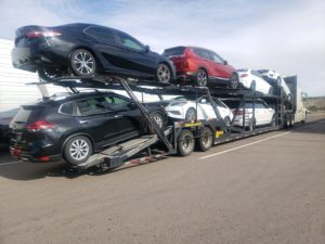 multiple vehicles on trailer for auto transport