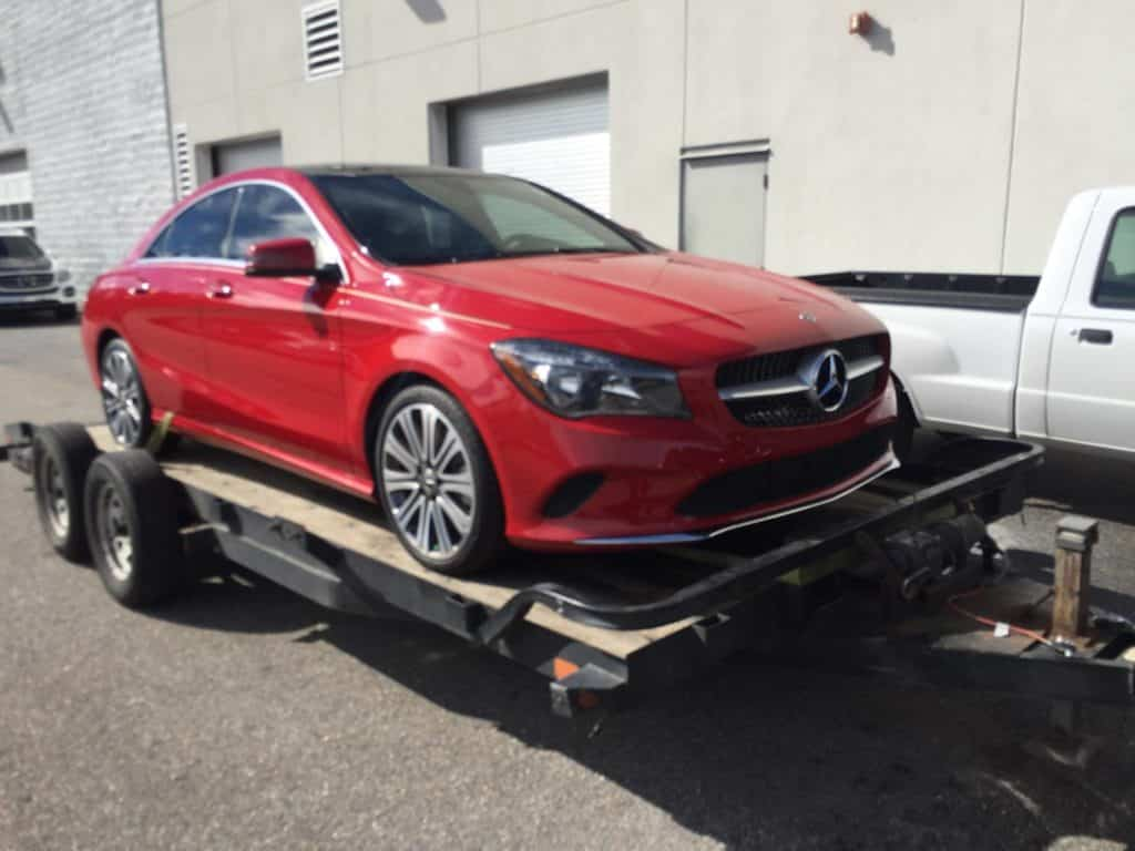 red mercedes c-class on autotransport.com's trailer
