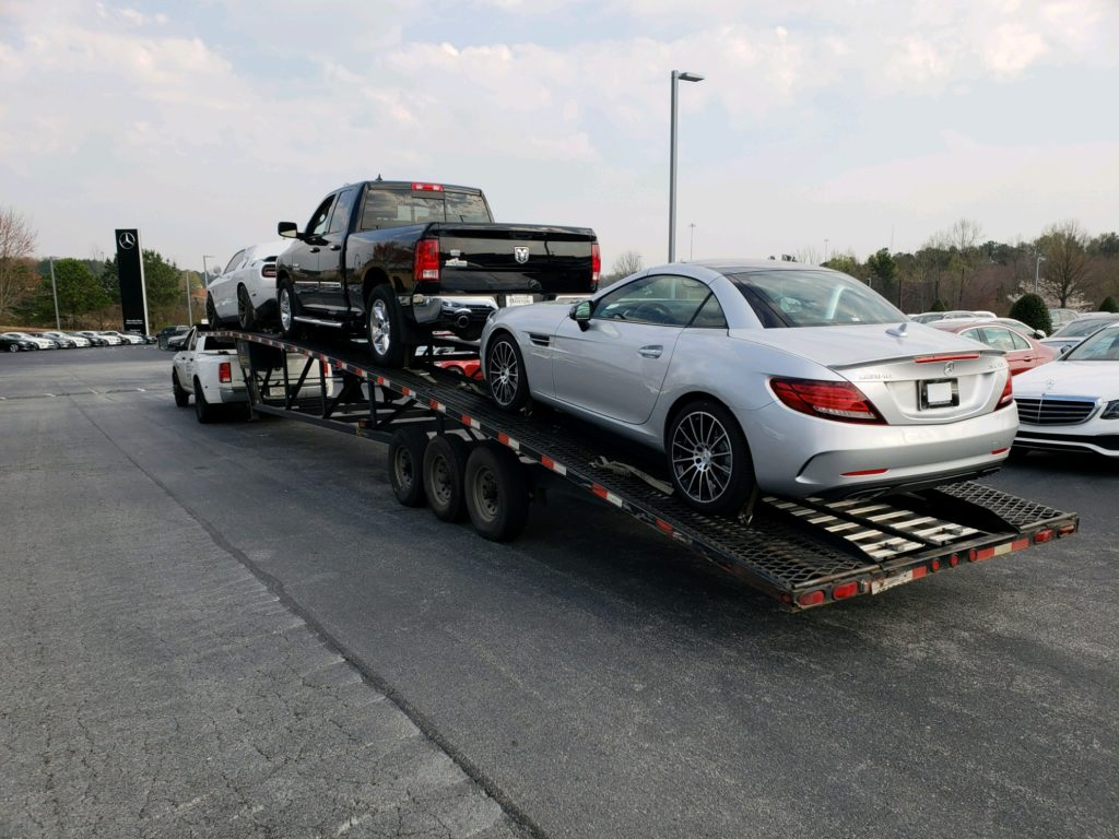 silver mercedes on trailer for auto transport