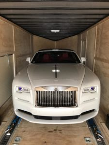 white rolls royce in enclosed trailer for auto transport