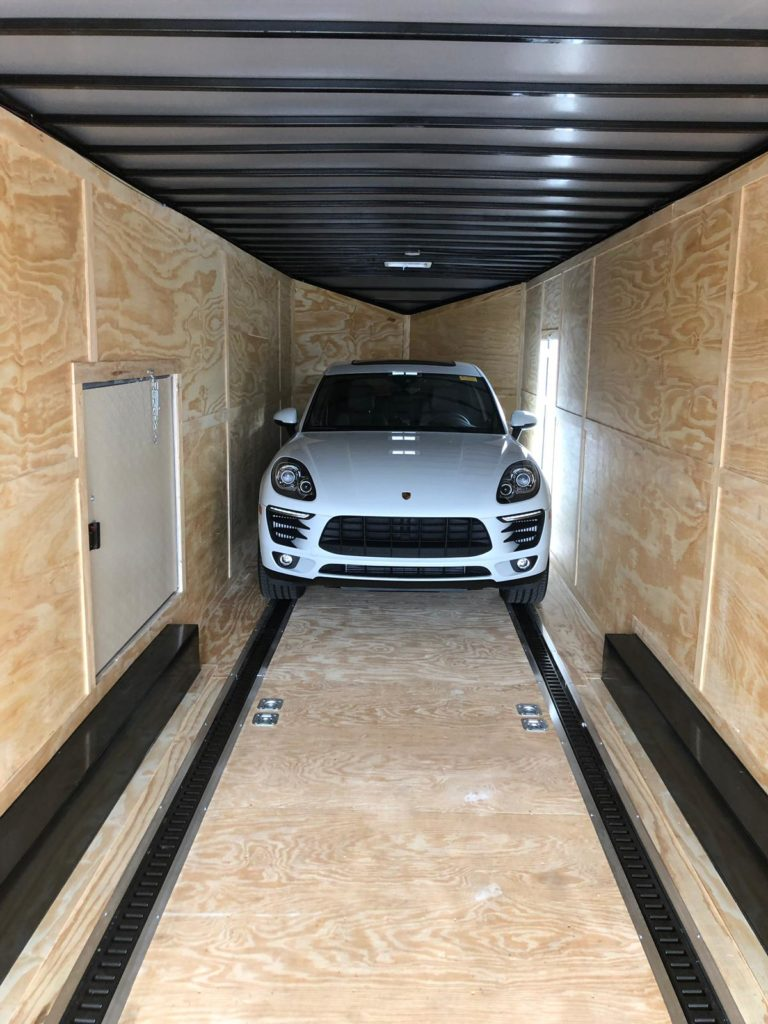 white caynenne porsche in trailer for auto transport