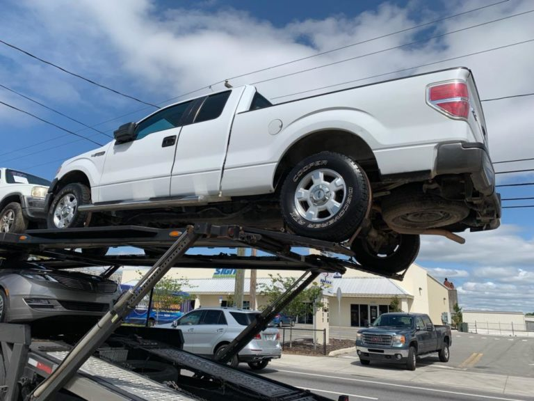 white commercial truck on trailer for auto transport