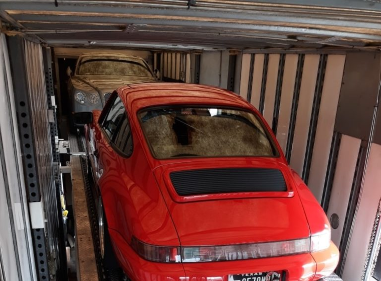 red porsche in enclosed trailer for auto transport