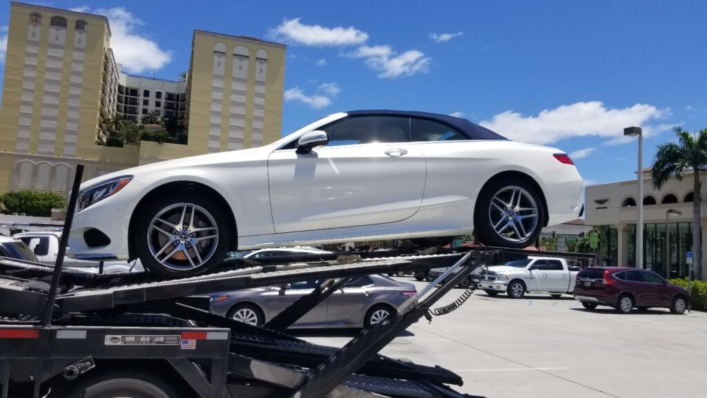 side shot of white mercedes ready for auto transport