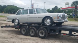 classic vintage mercedes on trailer for auto transport