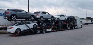 multiple vehicles on long haul trailer for autotransport