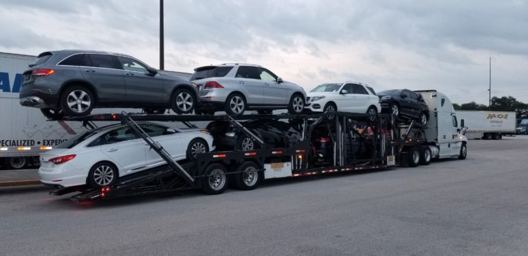 multiple vehicles on long haul trailer for autotransport