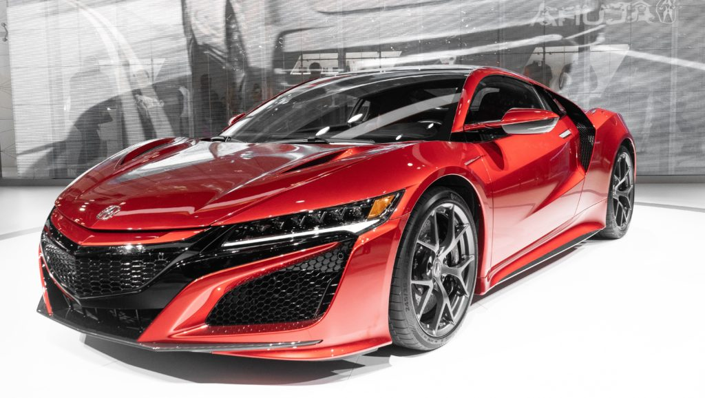 red hyper car acura brand on a white floor