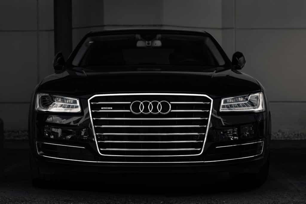 black audi car models in dim garage