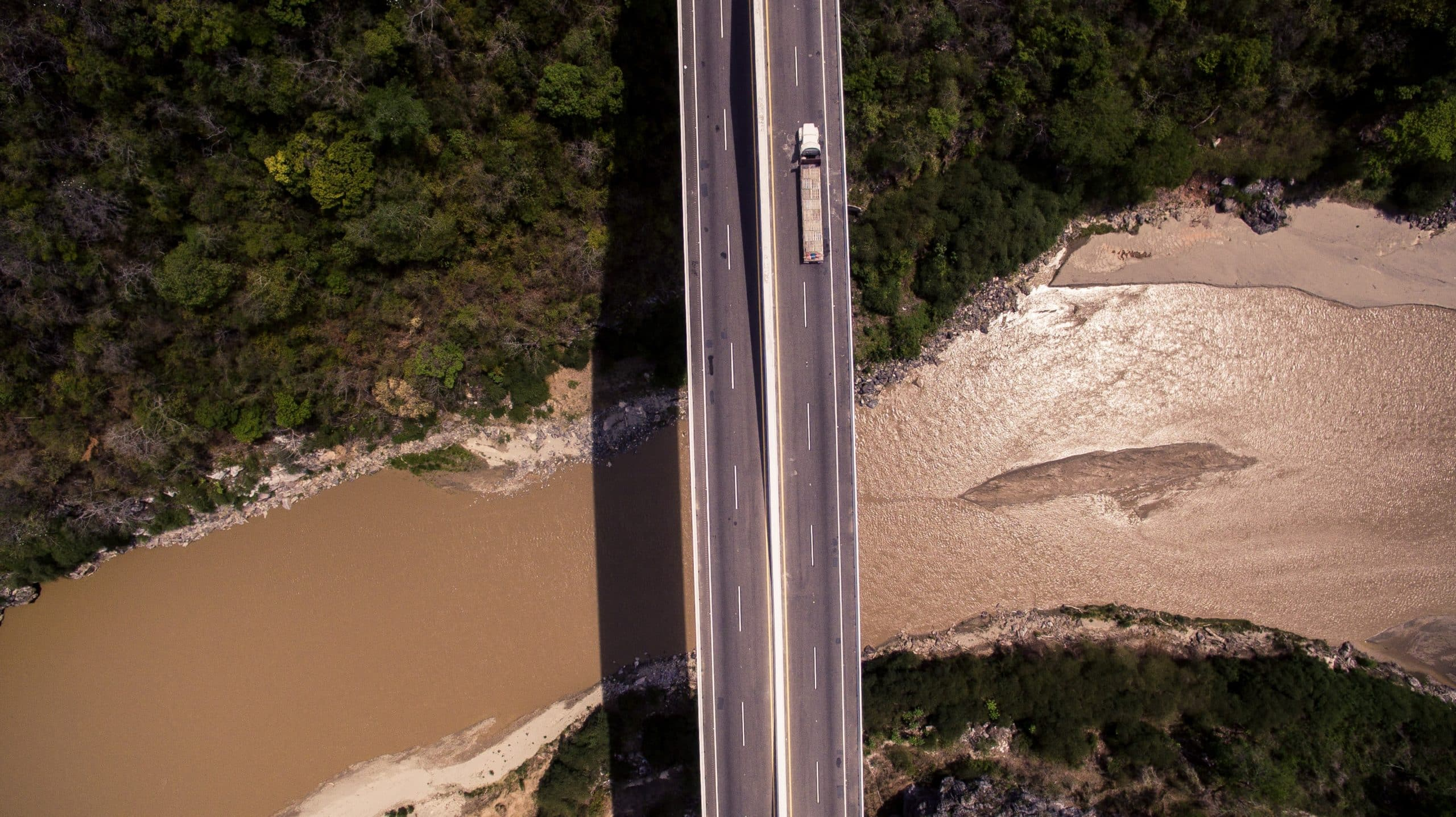 vetical road crossing river with auto transport load