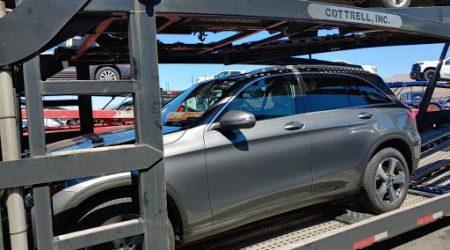 grey mercedes suv on transport trailer