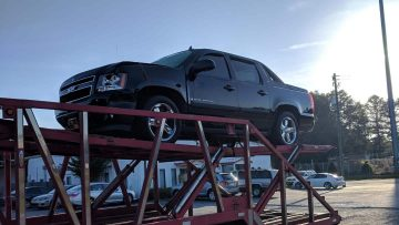 Chevrolet Avalanche being transported by our trailers