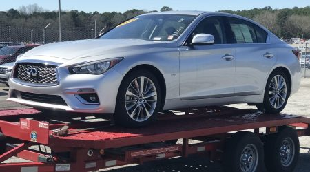 infiniti q50 on red trailer
